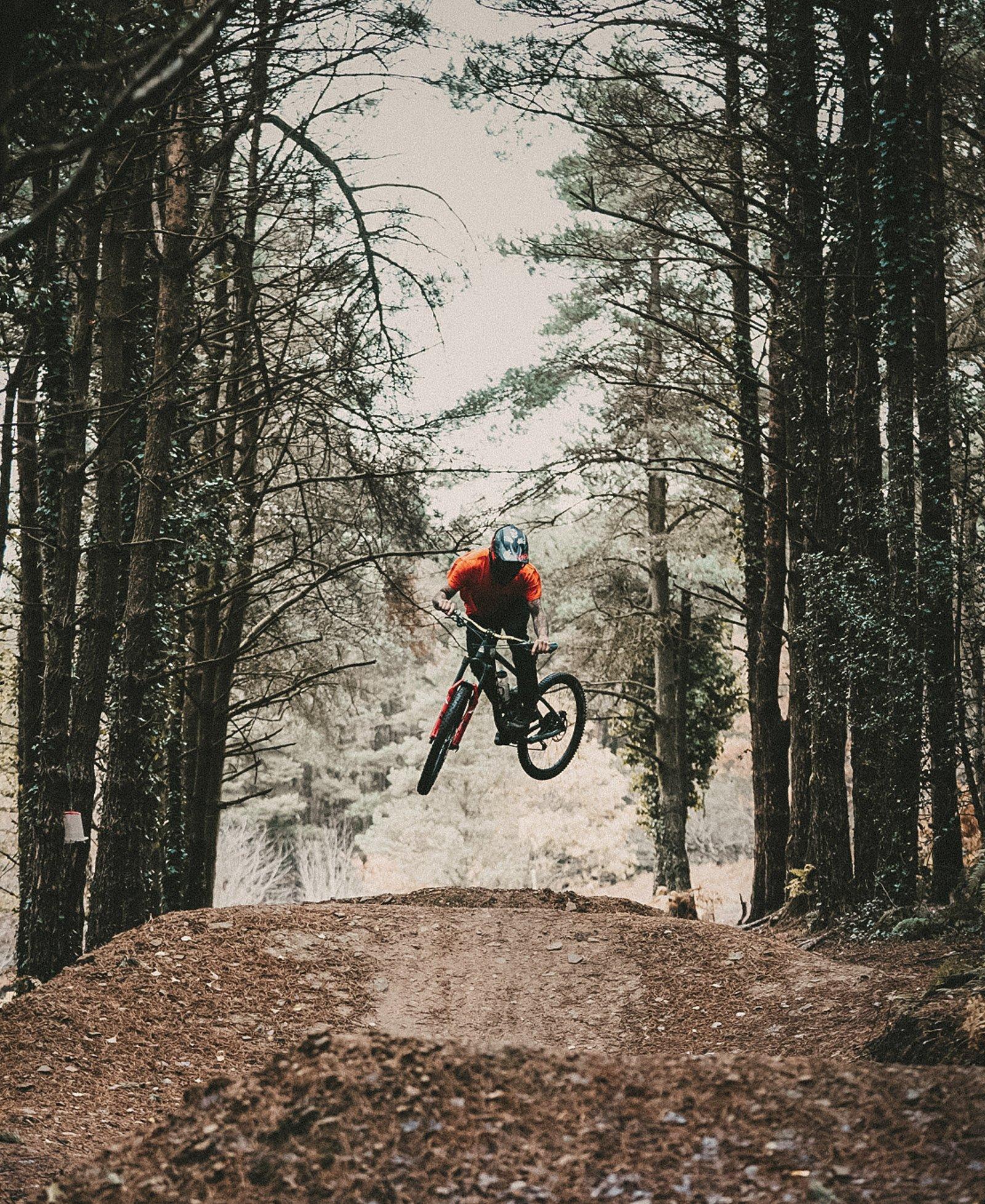 Mountain bike rider jumping on Goodyear tires
