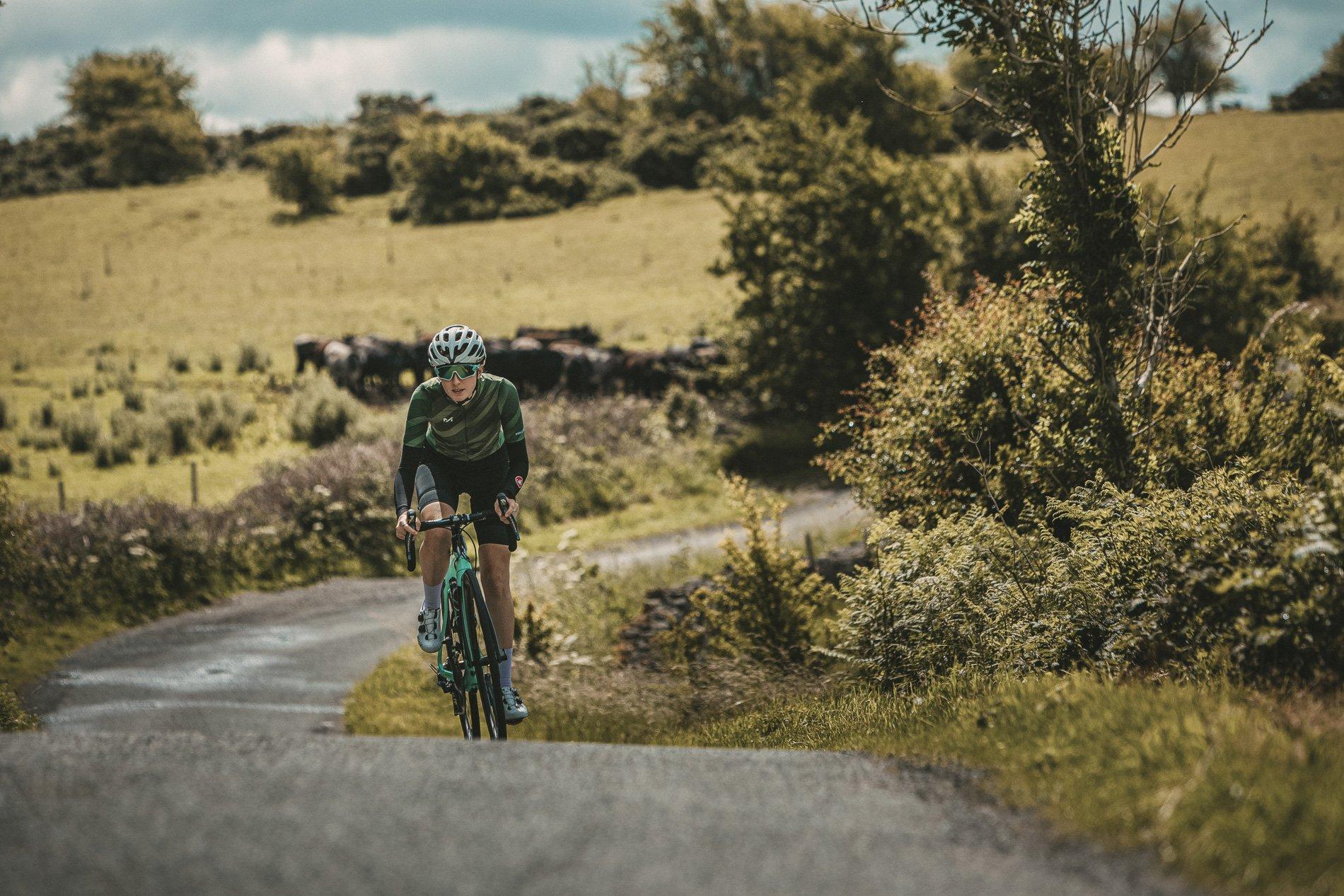 Female cyclist riding towards camera