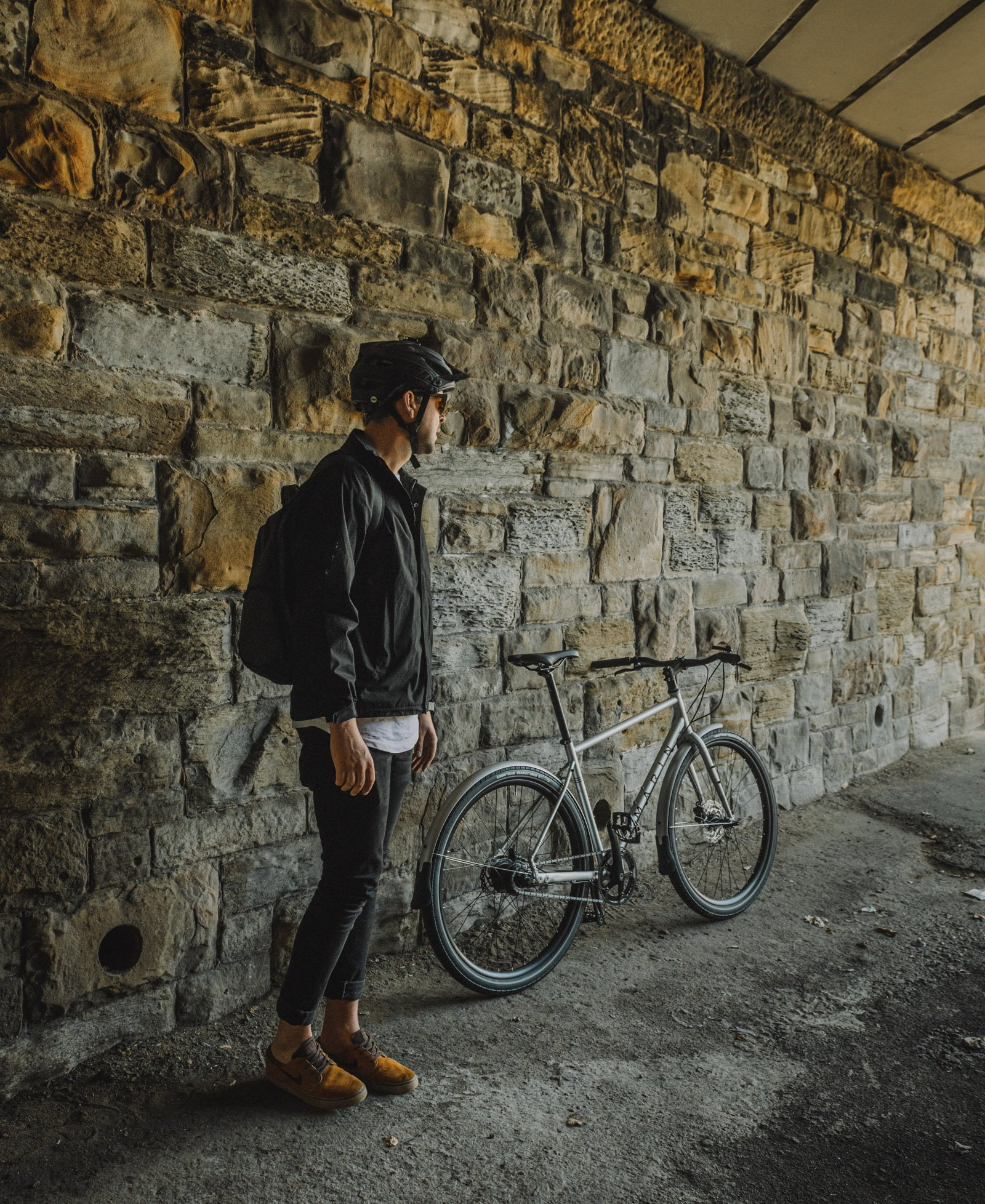 Commutor cyclist waiting in tunnel